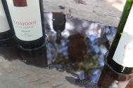 Lomond Merlot wine bottle with Wayne Gabb's reflection in water.