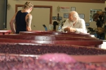 Steve Daniel and his son discuss the wine ferment at Danshi Rise winery in McLaren Vale Australia.