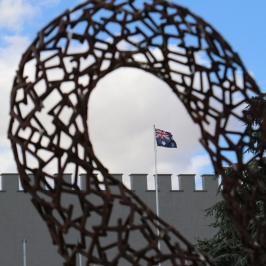 The Australian flag shot through a sculpture at Taylors Wines in the Clare Valley Australia.