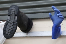 A boot and a glove hang on the wall at the Felton Road winery in New Zealand.