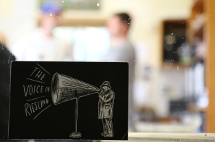 A voice of Riesling postcard sits in the window of the Greystone Wines lab in New Zealand.