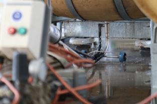 Cleaning the wine barrel at Charles Sturt University in Australia.