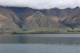 A view of mountains from a boat on Lake Wakatipu.