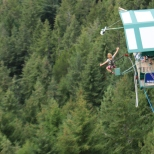 A bungee jumper launches himself off a platform in Queenstown.