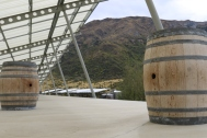 A mountain view with wine barrels at Peregrine Wines in New Zealand.