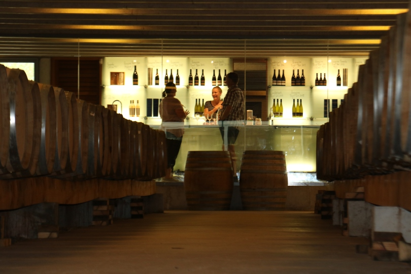 Having fun tasting wine at the Peregrine Wines cellar door in New Zealand.