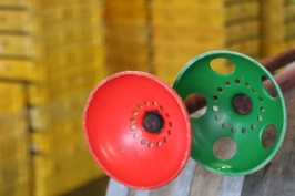 A red and a green plunger awaits some action in the Neudorf winery in New Zealand.