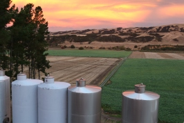 Escarpment tanks with a beautiful sky as the sun sets in Martinborough New Zealand.