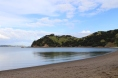 Beach on Waiheke Island at Man O War winery in New Zealand.