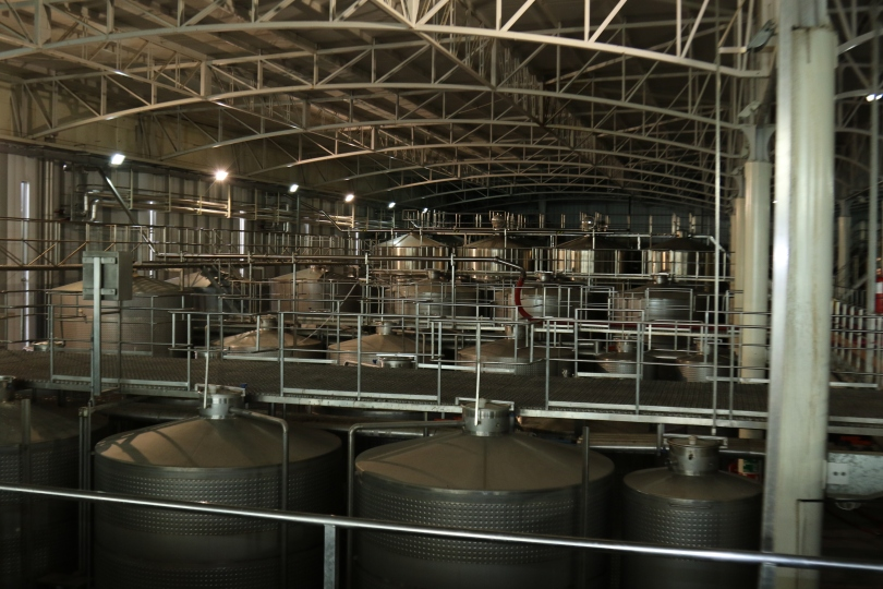 Large fermenting tanks inside the Indomita Winery in Chile.