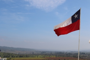 The Chilean Flag waving in the wind at the Indomita winery in the Casablanca Valley in Chile.