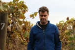 Guy Hooper the homemade winemaker of Caviahue Wines walks through his garden vines in Mapio Valley in Chile.