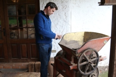 Guy Hooper of Caviahue wines tends antique wine equipment at his home in Maipo Valley in Chile.